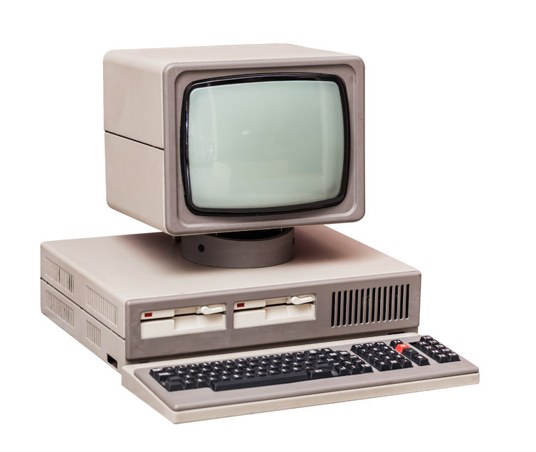 46042528 - old gray computer isolated on a white background